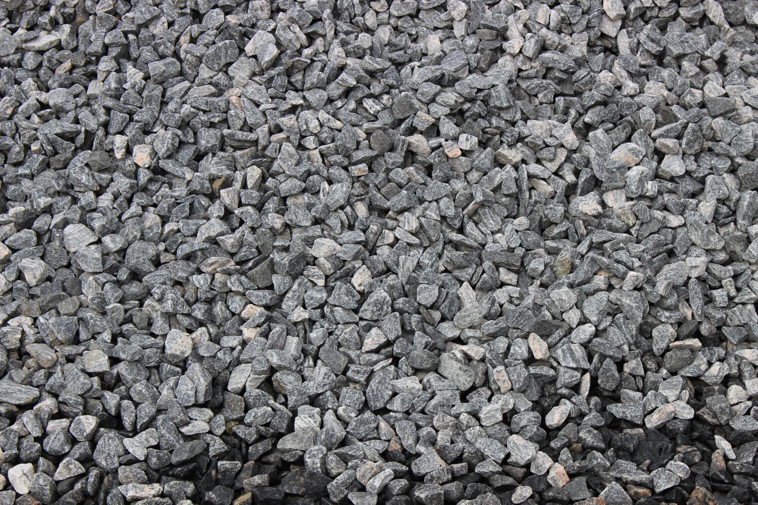Ohs landscape group order stone on line for Black granite landscape rock