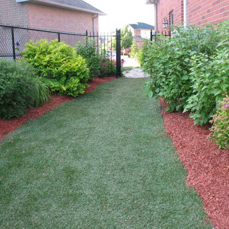 Synthetic Lawn and Red Devil Mulch
